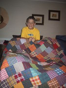 Copy of Jordan with his quilt 2005