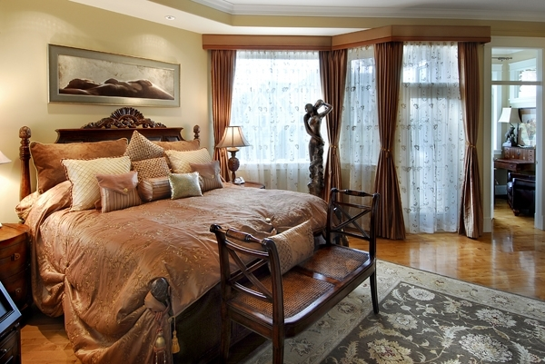 Master bedroom in gold and green