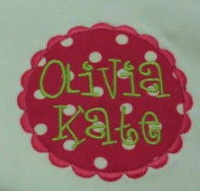 Appliqued oval patch with monogram