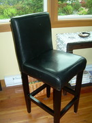 Leather bar stool before slipcovering