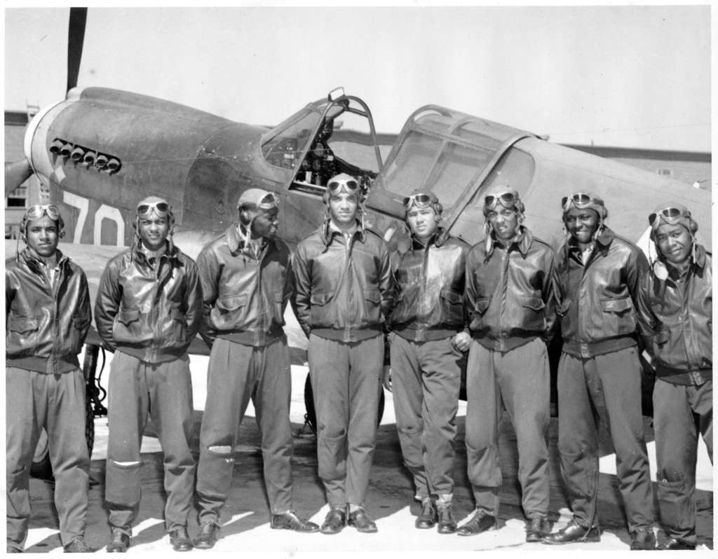 Tuskegee Airmen from class 42I posing in front of an airplane