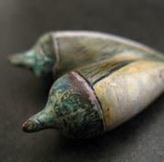 Close up of mokume gane pods