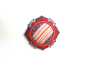 red brooch front