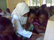 kaltuma shows the women teachers how it is done