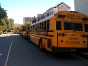 Line of buses at USC Grammy Career Day