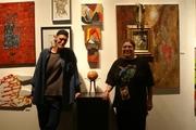 Bob Gavin and Mala Gavin at an art show.