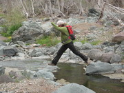 Mom showing the kids how to cross a creek!