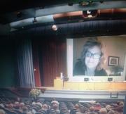 tori big head in auditorium