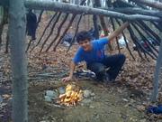 Building Natural shelters and fire by rubbing sticks together