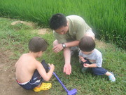 Baba catches frogs with boys