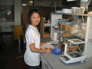 Gloria Hong recording research data in the lab