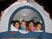 Girl Scouts participating in a Leave No Trace camp out.