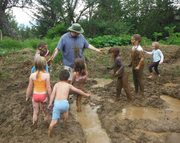 The muddying of an awesome dad begins