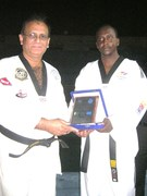 Master Omar Giving Shield to GM Zubairi