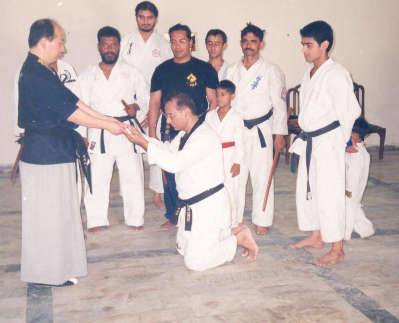 Grandmaster Kim Jeong Seong Presenting Training Sword to Master Zubairi.May 2006