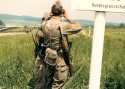 EAST German border patrol right up to the edge