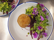 sheeps cheese croquette with pea shoots and flowers