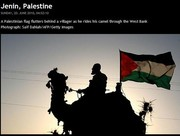 Palestinian on Camel with flag
