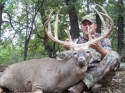 Johnny with his monster 193 7/8 in buck killed at all about u ranch and outfitters 10/12