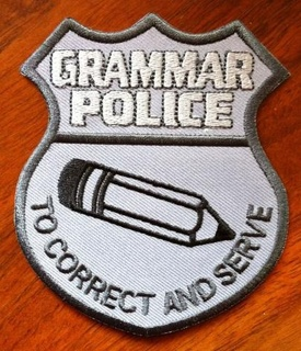 Grammar Police patch, in the shape of a police badge, with a pencil with eraser, and subtitled 'To correct and serve'