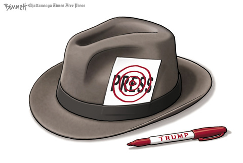 Press pass in the hat band of a reporter's fedora, with a red bulls-eye target drawn on it by a TRUMP marker