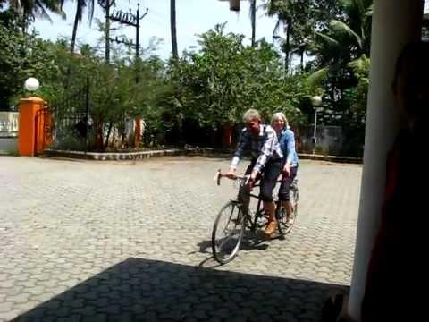 British couple demonstarting tandem bicycling in Kerala, India !