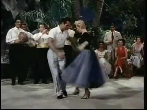 Lição de Dança: Ricardo Montalban, Lana Turner e Rita Moreno Caem no Samba.