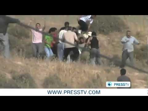 colonos extremistas judeus abrem fogo contra palestinos na Cisjordânia ocupada. Sob o olhar de soldados judeus que nada fazem