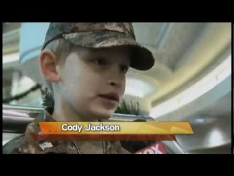 Boy Salutes Soldiers
