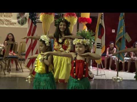 MECATX queen and princess doing a Hawaiian dance