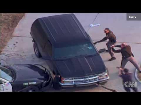 Cop smacks car, arrests driver