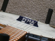 3-D Printed Banjo Bridge with my name cutout, Peter.
