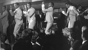 The Temptations and Cornelius Grant Musical Director On the far Right