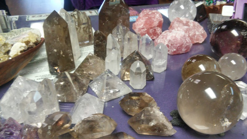 crystals, polished stones, carved totems, stone bracelets