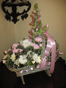 1920's wicker doll cradle makes a great centerpiece for a baby shower