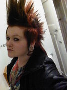 Most recent. Red & black striped mohawk.