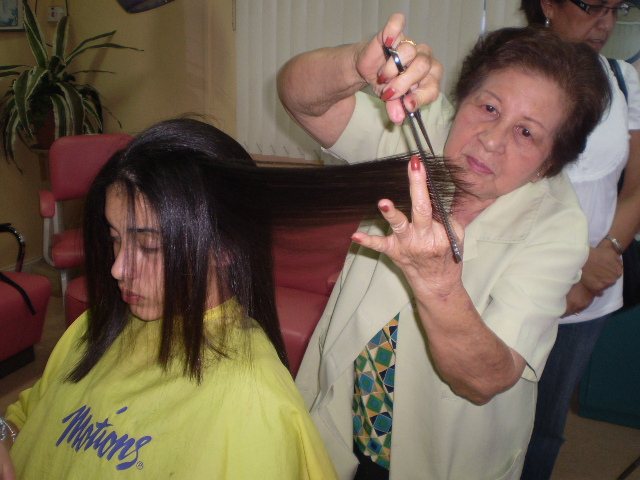 Kim  Aleong who is 84yrs old and still cutting hair