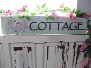 Bike on 75 yr Old Wood Sign 'Cottage'