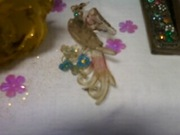 better close up of OLD lucite bird pin pastel hues glitter and rhinestones