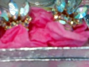 closeup of antique rhinestone icing style clips with silver foiled keepsake box