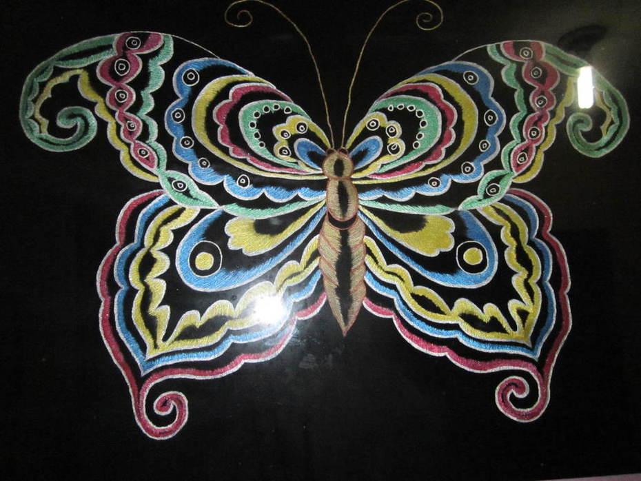 Mariposa en pirograbado