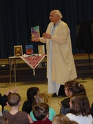 Showing children the book version of the Palestinian folktale I have just told them.