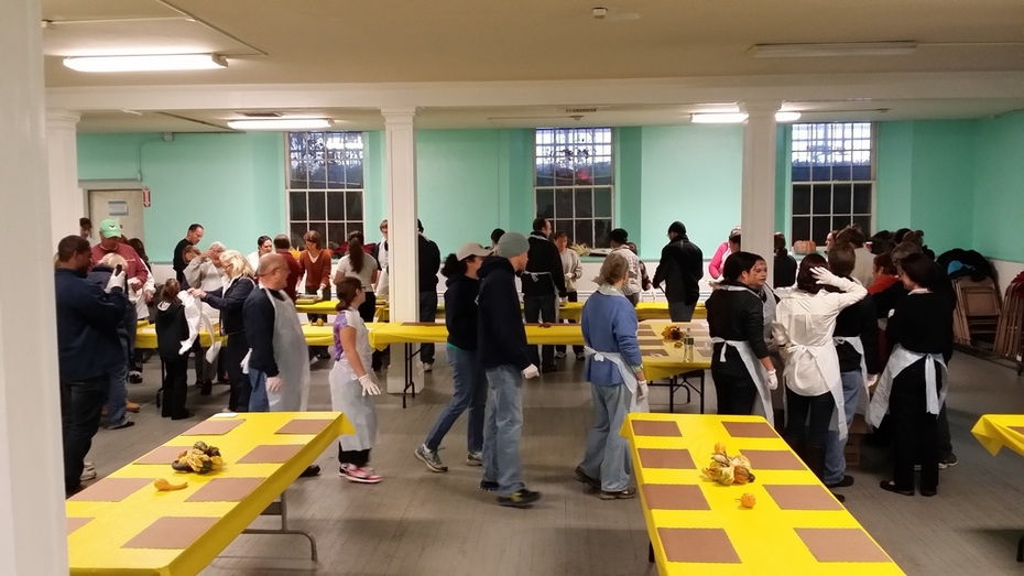 Volunteers filling to go containers