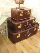 set of three leather bound luggage