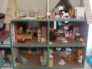 Inside the dollhouse - some what a mess - Grandkids redecorated it :0)