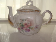 Floral design porcelain tea pot