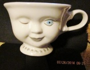 Collector winking tea cup