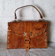 Sweet, vintage tooled leather handbag