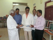 BOOKS PRESENT TO HONOURABLE DIRECTOR AT THE EXHIBITION HALL