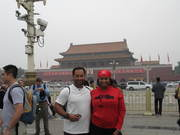 Jeannie & Taj Johnson in front of China's Forbidden City entrance (Sept. 2011)